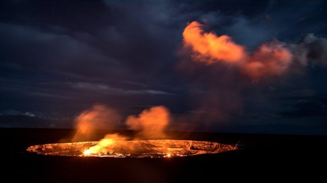erupting lava glowing at night