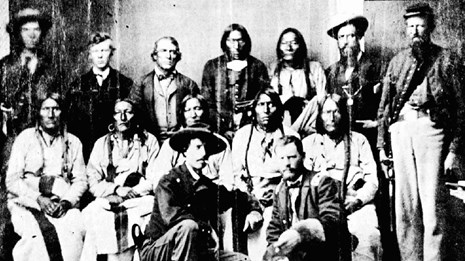 black and white historical photograph of the chiefs of several plains tribes and US representatives
