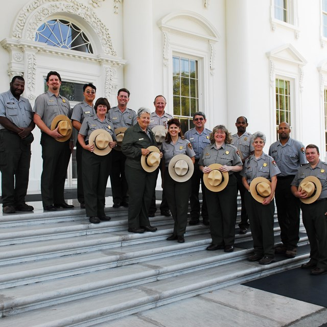 A group photo of some of the Park Rangers in front of the White House.