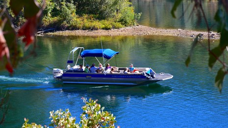 A patio boat on Whiskeytown Lake.