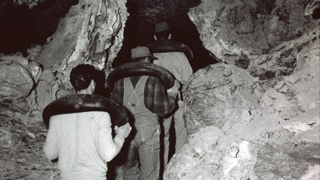 Men hauling cement into the cave.