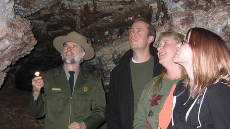 A ranger shows visitors Wind Cave