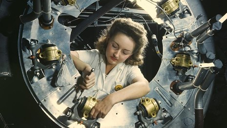 Part of the motors for a B-25 bomber is assembled in California. Courtesy of Library of Congress.