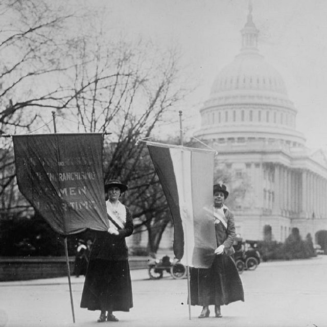 Black and white photo of women picketing near Capitol Building, Library of Congress.