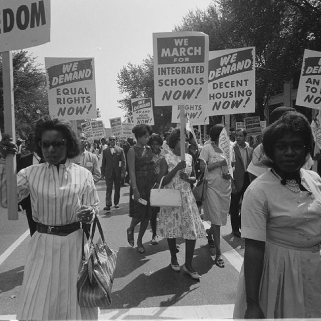 African Americans protesting and holding signs. LOC.