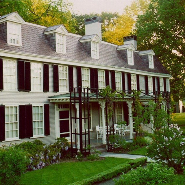 Photo of a two story house with gardens, courtesy NPS.