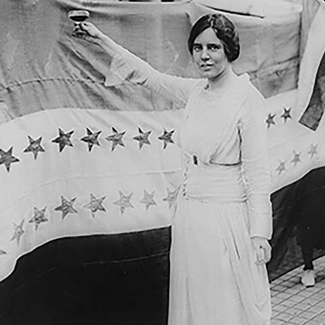 Alice Paul toasting the passage of the 19th Amendment. Library of Congress