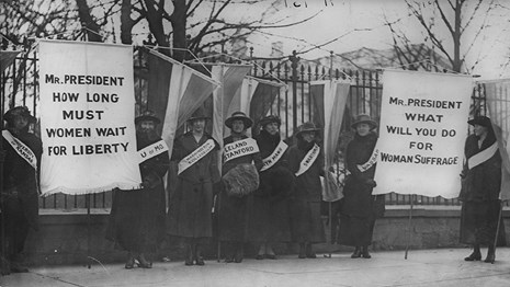 A historical photograph of women picketing the White House.