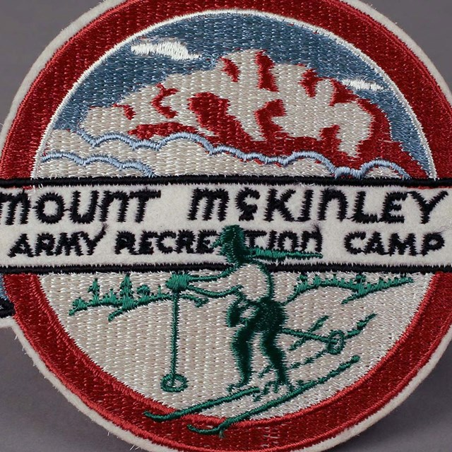 a patch reading 'Mount McKinley Army Recreation Camp'