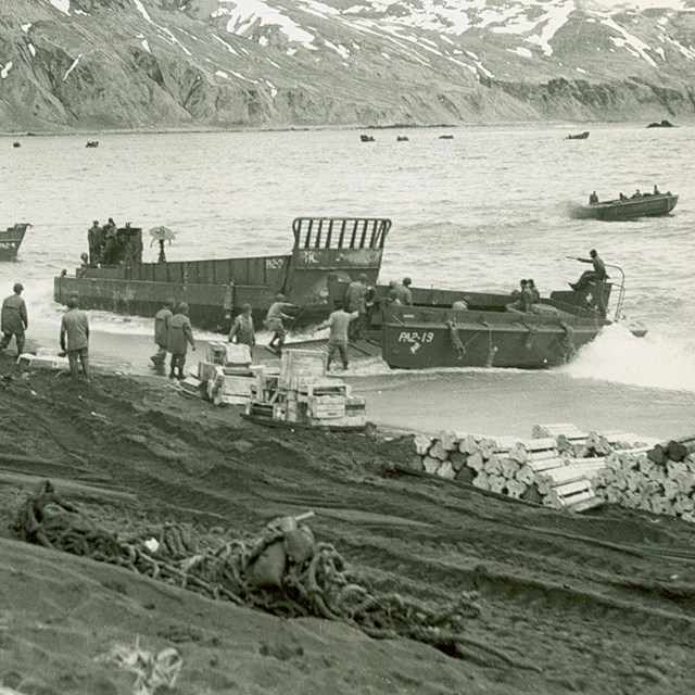 B&W of WWII military boats coming ashore