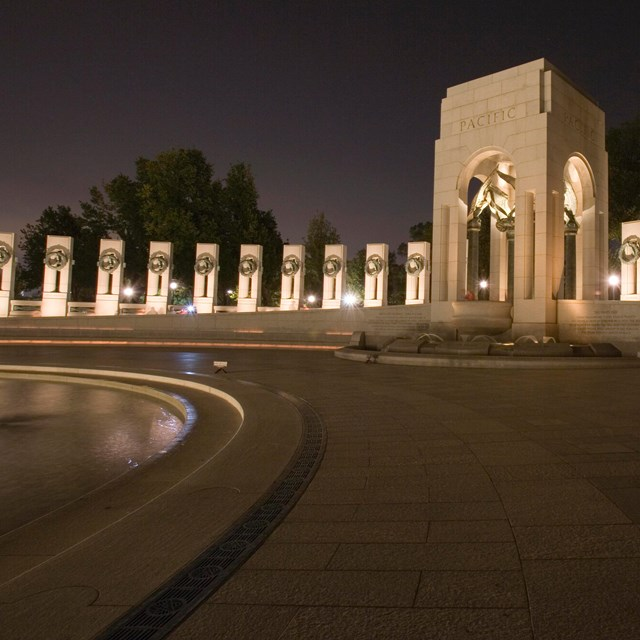 nighttime view of memorial with fountains