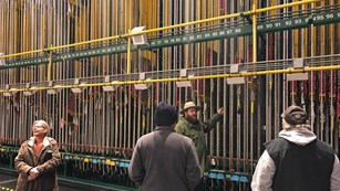 An NPS ranger explains the theater's fly line system.
