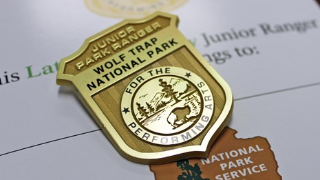 Wolf Trap Junior Ranger book and badge