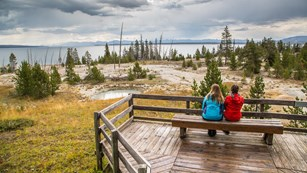 People enjoying the views at the West Thumb Geyser Basin.