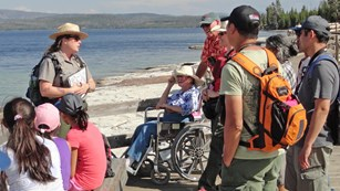 Park ranger discussing park resources with visitors at West Thumb Geyser Basin