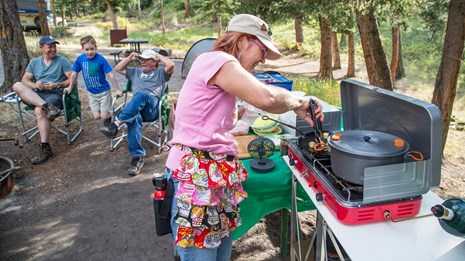 Campers preparing dinner in the Tower Campground