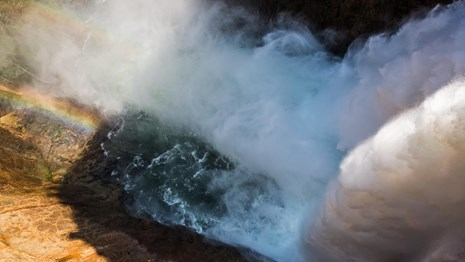 Water flows over the Brink of Lower Falls in the Grand Canyon of the Yellwostone