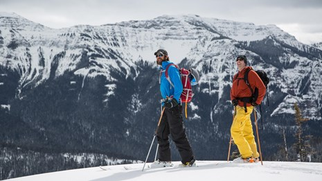 Two skiers explore the mountains of Yellowstone.