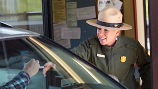Photo of a park ranger at an entrance station