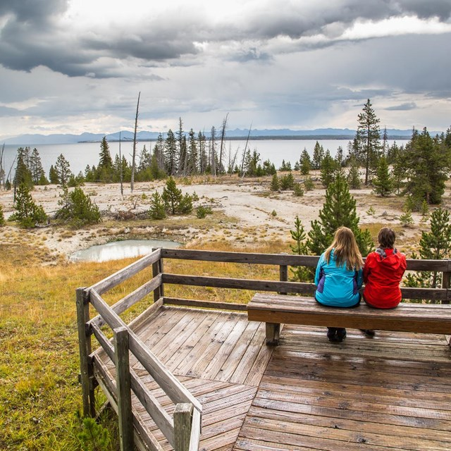 People enjoying the views at the West Thumb Geyser Basin