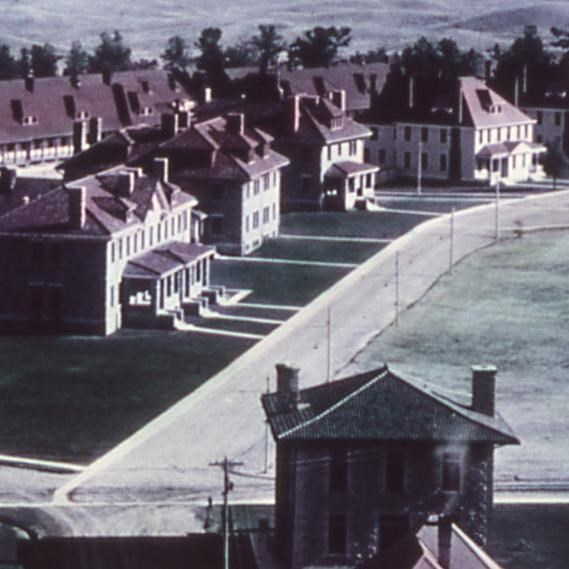 Historic photograph of Fort Yellowstone showing the red-roofed buildings of Officer's Row.