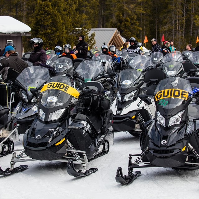 Snowmobiles parked at the Madison Warming Hut