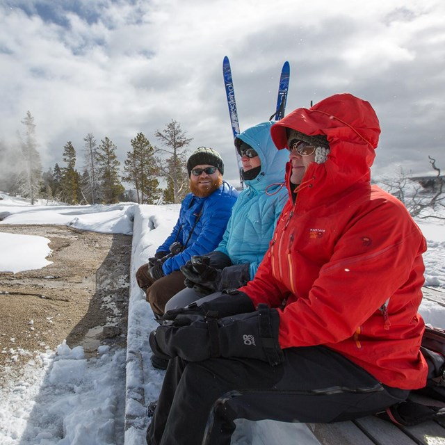 People bundled up while waiting for an eruption of Grand Geyser.