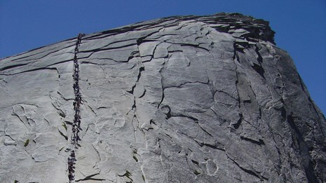Hikers going up the Half Dome cables