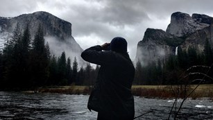 Person taking pictures from Valley View in Yosemite Valley