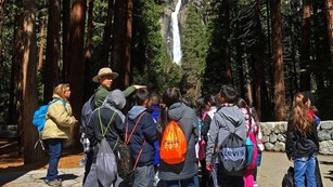 Ranger leading group of students to Lower Yosemite Fall