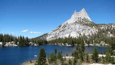 Cathedral Peak rises beyond one of the Cathedral Lakes
