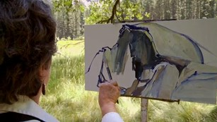 Artist painting a picture of Half Dome