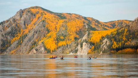 Kayakers on the Yukon River in fall