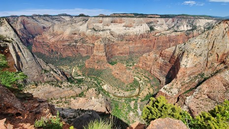 A winding canyon below a viewpoint.