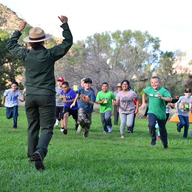 Education ranger plays game with students