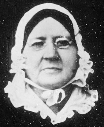 Photograph of Mary Pickersgill: small glasses, black hair, white bonnet