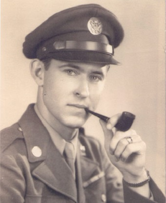 black and white portrait of a man in uniform with a pipe