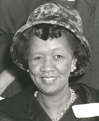 B&W photo of Ms. Height wearing a hat and black suit