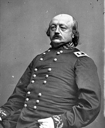 B&W photo of butler seated in Civil War Uniform.  He is bald with dark hair and a mustache.