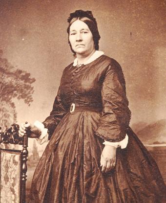 Photograph of Eloisa McLoughlin wearing a dark dress.