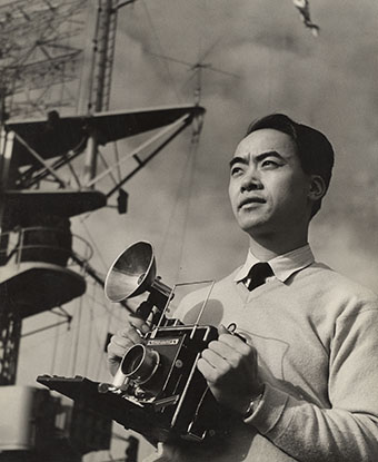Photograph of man holding camera