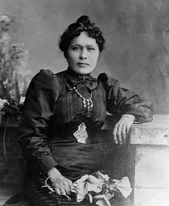 Black and white historic photo of woman in dress