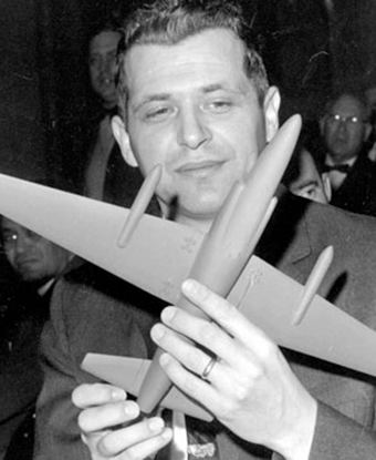 Gary Powers holds a model of a U-2 spyplane after his release from captivity