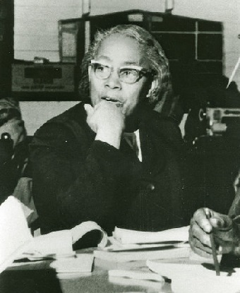 Septima Clark at a desk with papers on it.