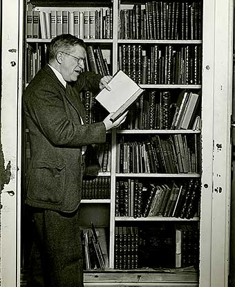 Harry Dana reading a book in the Study vault of the Longfellow House