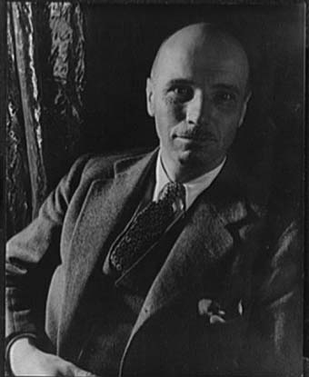 A black and white photo of Rockwell Kent, wearing a suit.