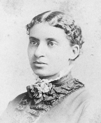 Black and white photo of Charlotte Forten Grimké from the shoulder up.