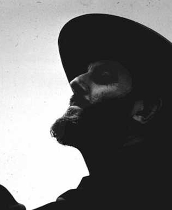 Black and white image of a bearded man's profile