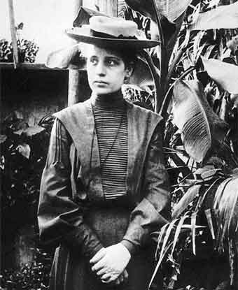 woman in 19th century clothing in front of banana tree