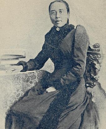 woman sitting for a photograph